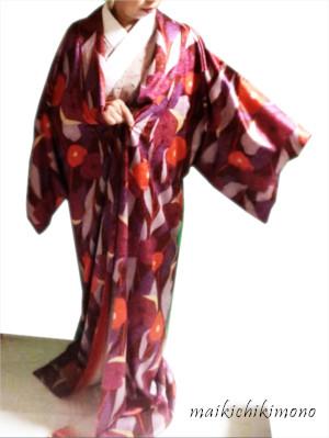 put your arm through the kimono sleeve